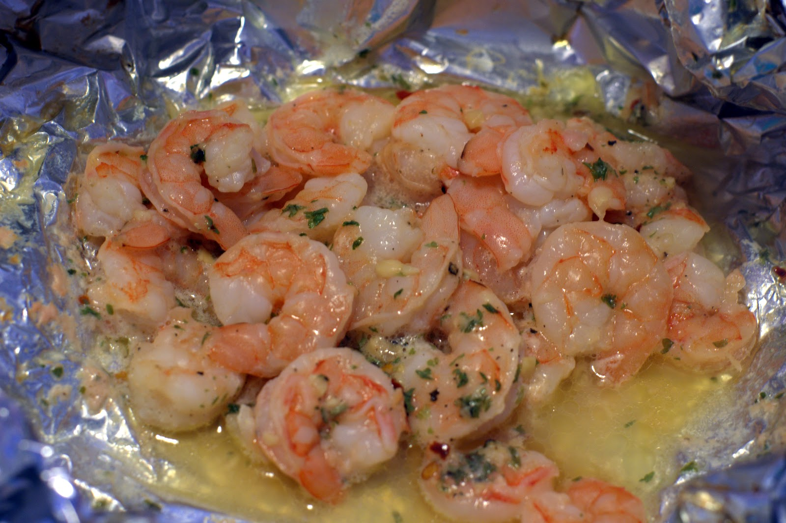 woman shrimp pasta in a foil package the woman shrimp pasta in a foil ...