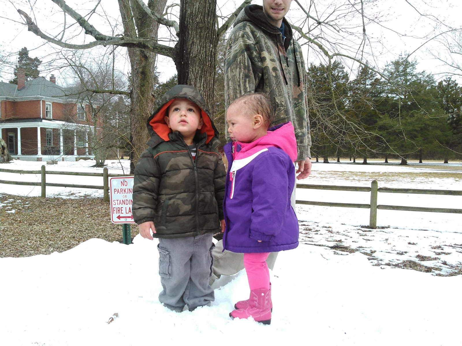 Brooklyn, who has ichthyosis, and her brother in the snow
