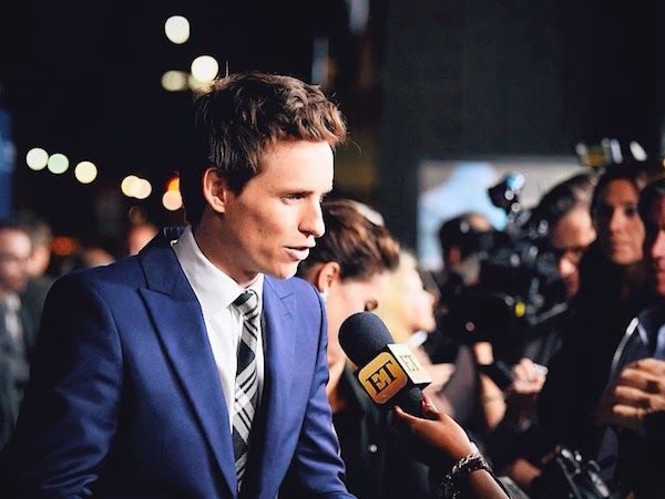 Eddie Redmayne wears Alexander McQueen Pre AW14 blue one-button suit with McQueen shoulder and silk check tie to attend the premiere of 'The Theory of Everything' in Los Angeles, on Tuesday 28th October 2014