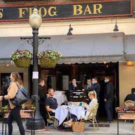 Outdoor dining at Hugo's Frog Bar.