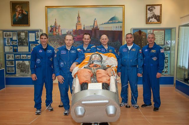 Touring the Korolev Museum at the Baikonur Cosmodrome in Kazakhstan, the Expedition 37/38 prime and backup crew members pose for pictures by an old Russian launch and entry suit Sept. 20. From left to right are prime Flight Engineer Michael Hopkins of NASA, prime Soyuz Commander Oleg Kotov, prime Flight Engineer Sergey Ryazanskiy and backup crew members Oleg Artemyev, Alexander Skvortsov and Steve Swanson of NASA. Hopkins, Kotov and Ryazanskiy are preparing for launch Sept. 26, Kazakh time, in the Soyuz TMA-10M spacecraft to begin a five and a half month mission on the International Space Station. Photo credit: NASA/Victor Zelentsov