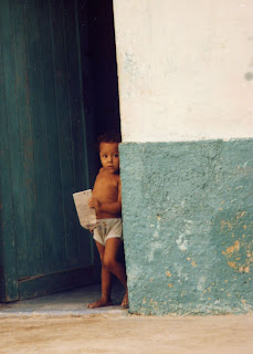 little boy standing in doorway Isla Mujeres Mexico