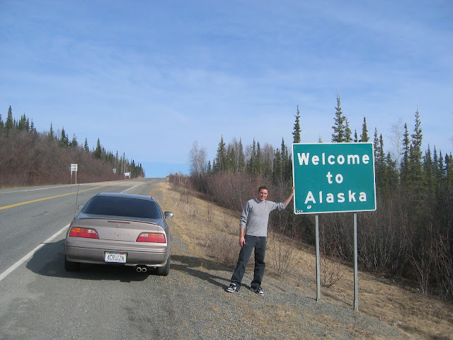 Tyson Hugie and his 1994 Acura Legend Coupe at the Alaskan border