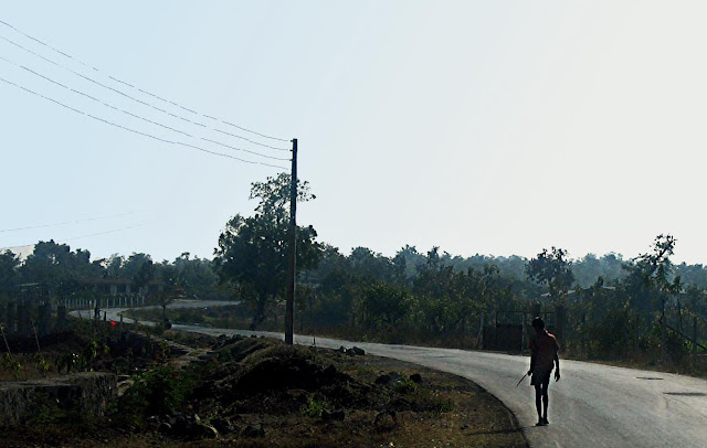 boy on country road in India