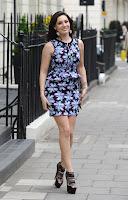 Kelly Brook wearing a short dress