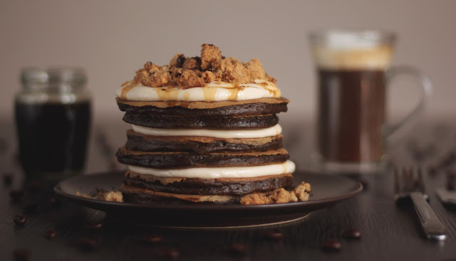 A sweet coffee pancake stack to start your morning - topped with classic cheesecake frosting, coffee crumbles and espresso syrup. Even if you don't like coffee, you'll like this recipe! Created by the German food blog Pancake Stories.