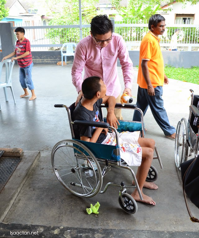 Another DeBancco group member giving some care and attention to the children