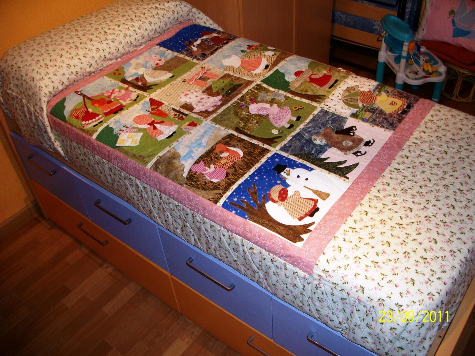 Colcha patchwork con 12 mu ecas sue patchwork isabel for Fotos de patchwork