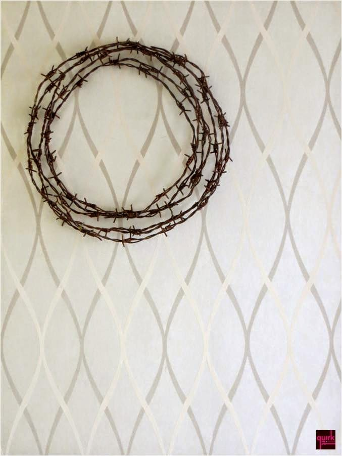BARBED REFLECTION_wreath of barbed wires around a mirror_diy_quirky_home_decor_quirkitdesign_mirror