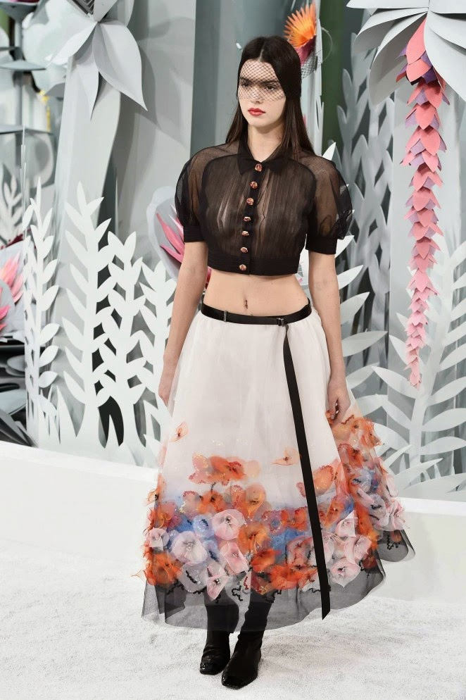 Kendall Jenner bares midriff in a sheer blouse at the Chanel Haute Couture Spring/Summer 2015 Fashion Show in Paris