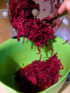 Spoon Scraping Beets from Food Processor into Bowl