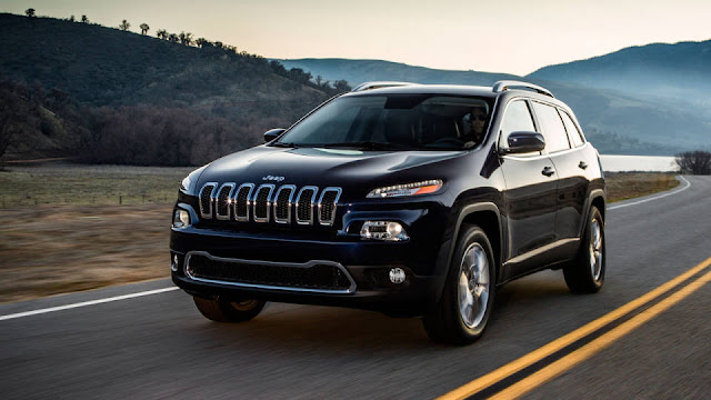 2014 Jeep Cherokee driving on mountain road