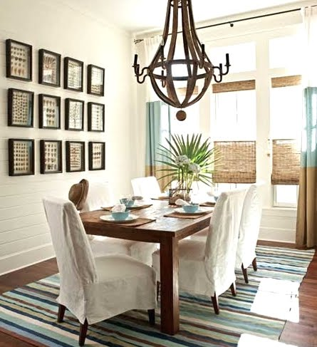 gallery wall with shell art in dining room