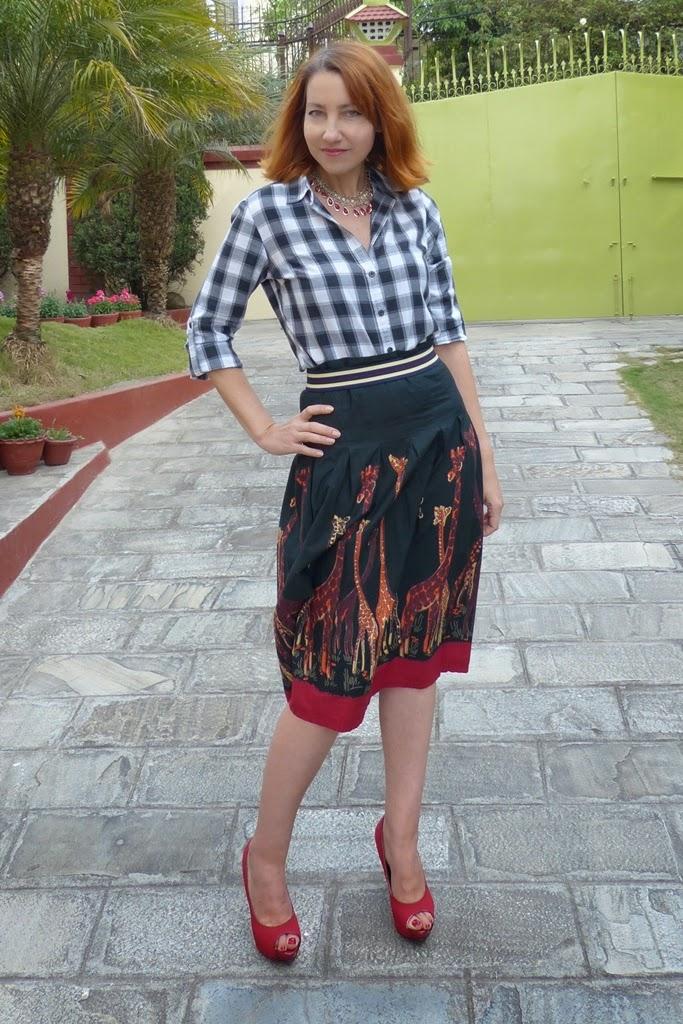 Checkered shirt, African print skirt
