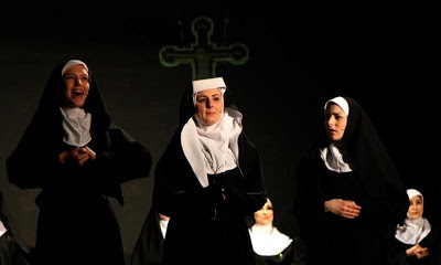 Close up of Mother Abbess with two Sisters