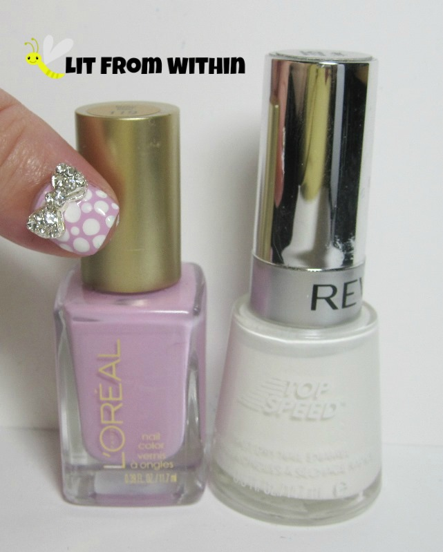Bottle shot:  L'Oreal Lacey Lilac, and Revlon Spirit.