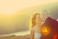 Heather and Matt kiss at Sunset   Cave B/Sagecliffe