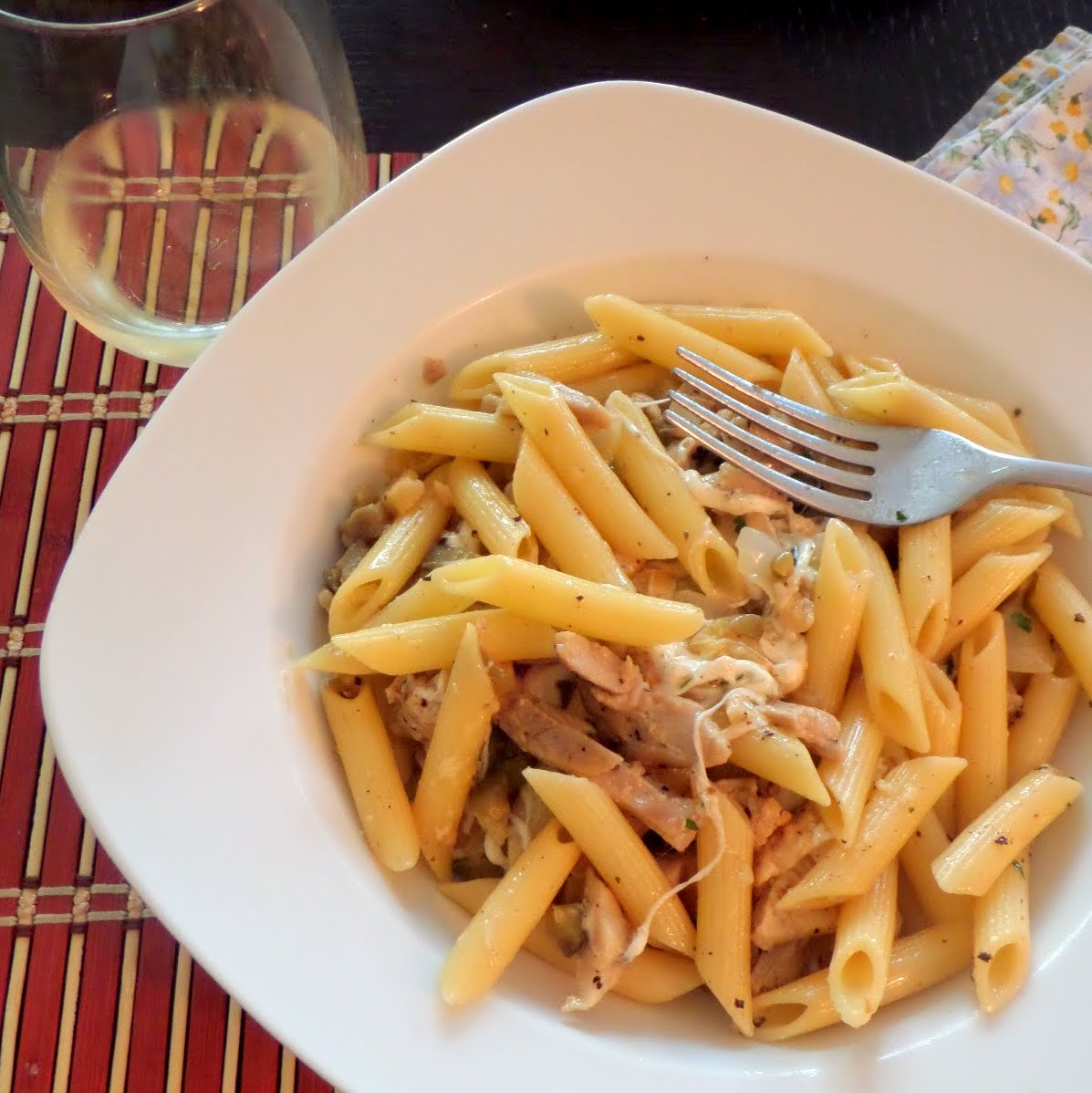 Cheesy Chicken Garlic Penne:  Penne with chicken, garlic, and cheese in a white wine sauce