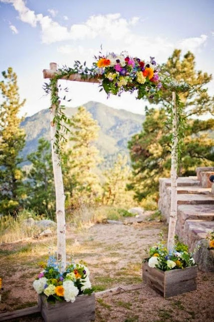 simple wedding arch with fresh spring flowers