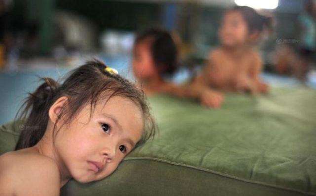 الصين وكيفية صناعة الأبطال الألومبيين China-gymnasium-Olympic-children-45