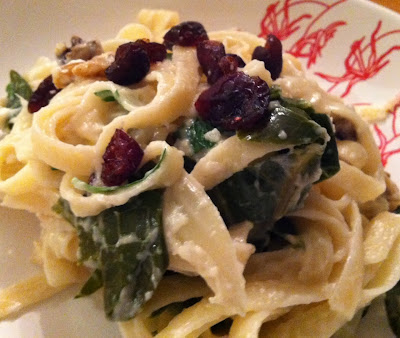 fettucine tossed with turnip cream, collard greens, cranberries and walnuts