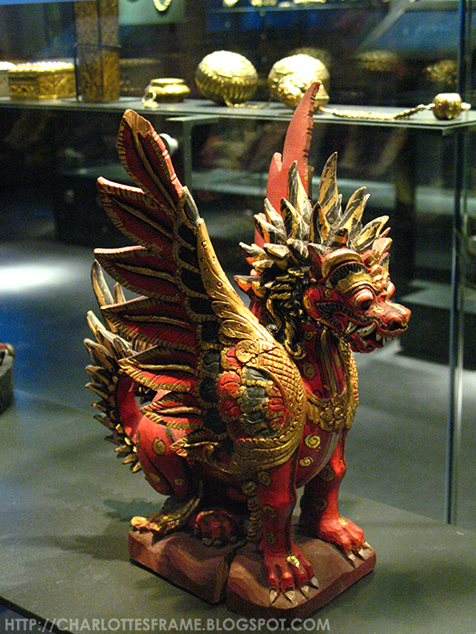 painted sculpture of a winged lion