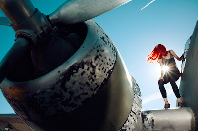 woman near airplane wing, fashion shoot in airport, jamie nelson photographer