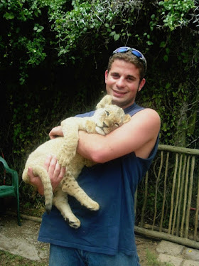Drew with a brand new lion cub.