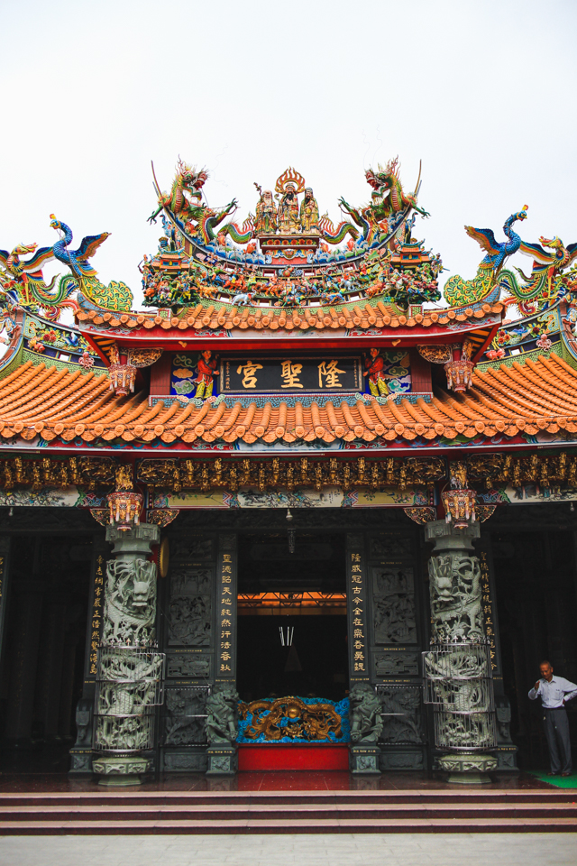 colorful dragons and intricately carved stone columns at a temple in Emei, Taiwan