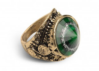chunky gold and green ring with swirls and beading around the setting