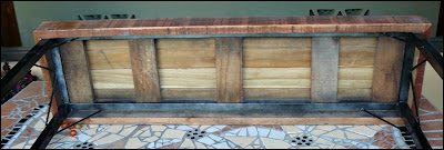 underside of wooden bench