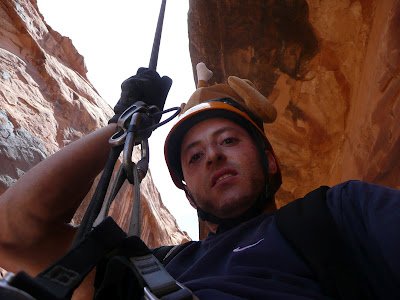 Rappeling down 150 foot drop in Moab, Utah