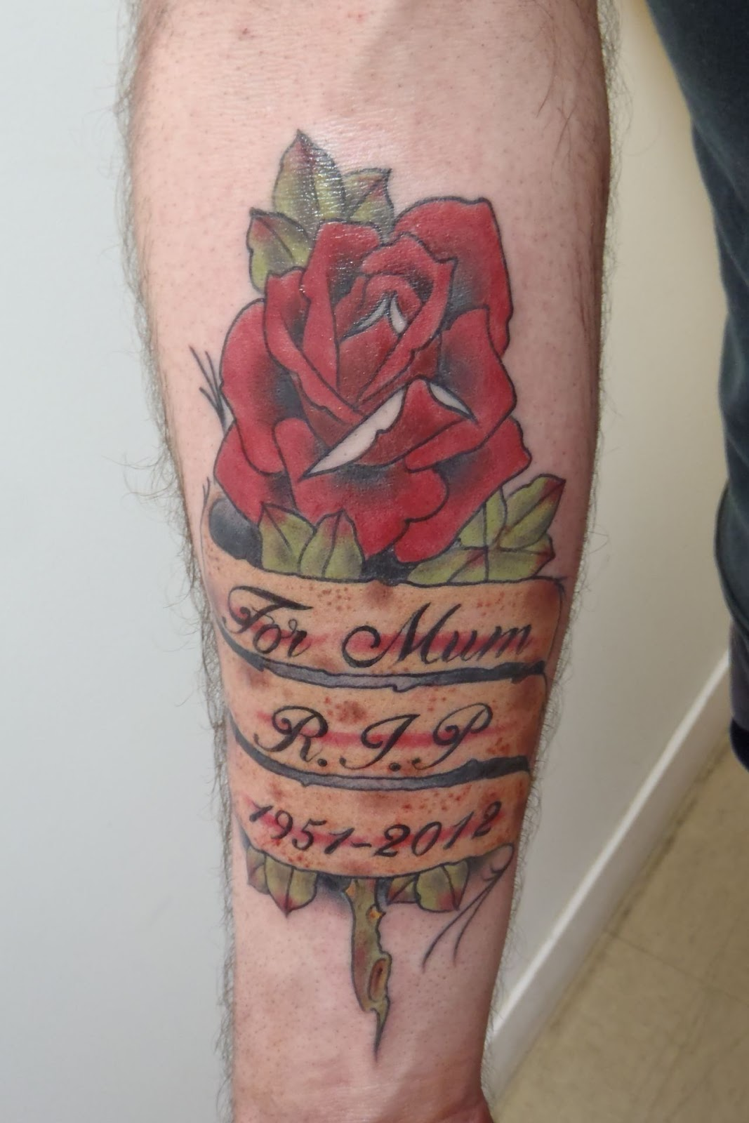 Mick's Tribute Rose. Tattoo by Rochey