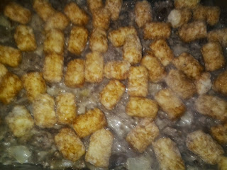 Easy Tater Tot Stroganoff Casserole topped with tots