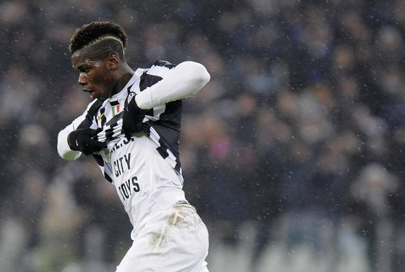 Juventus player Paul Pogba celebrates after scoring his team's fourth goal against Sampdoria