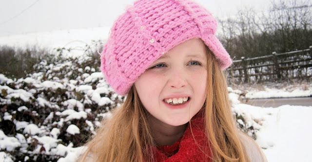 pink hat pretty girl in snow uk