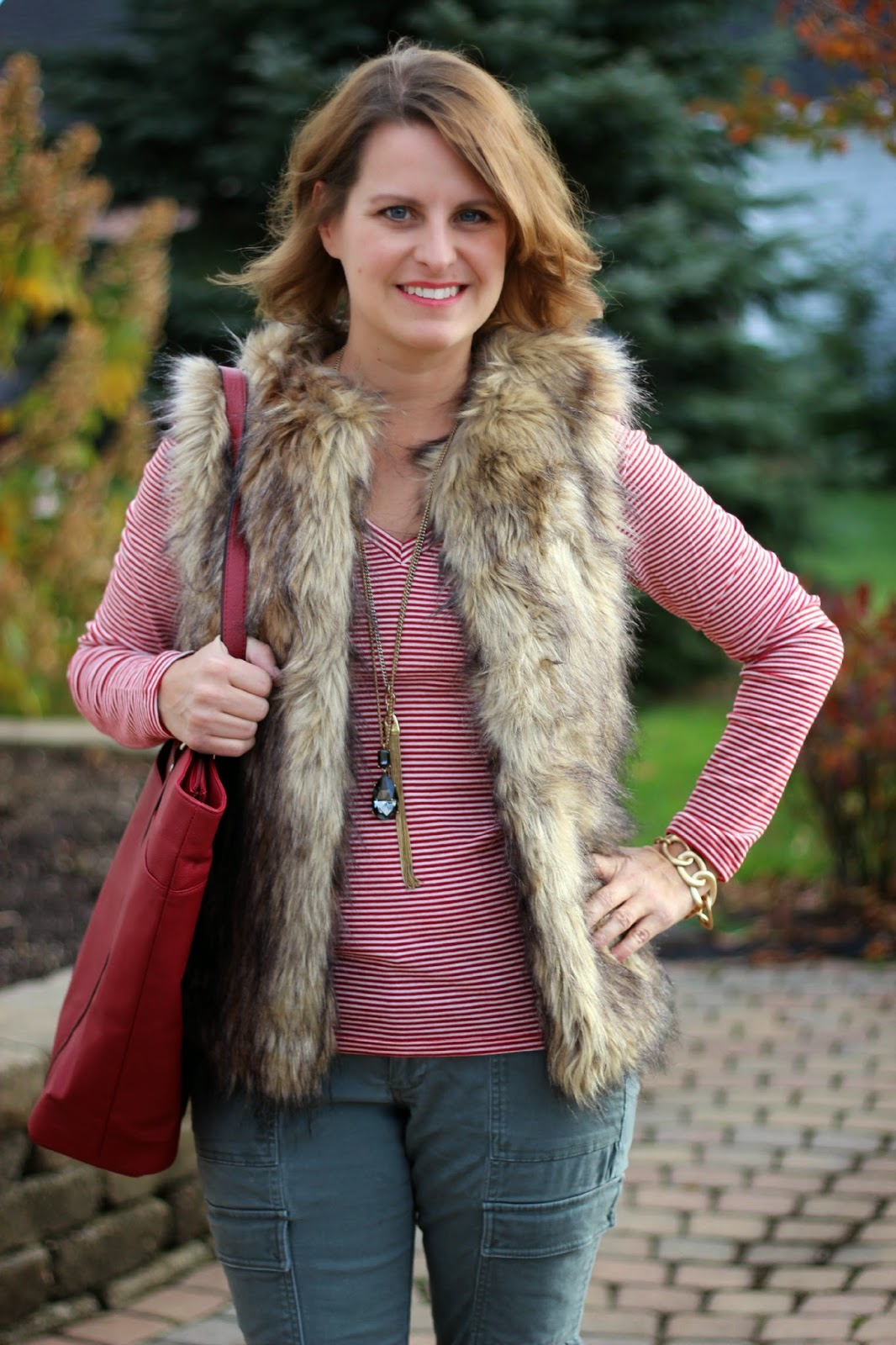 Fall outfit, fall fashion, fall look, faux fur vest, stripes, army green cargos, taupe booties