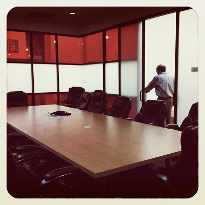 GotPrint conference room table and employee at the door