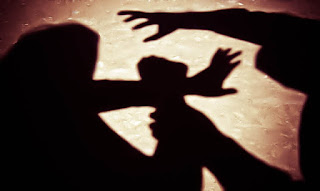 Shadow of a man attacking a women
