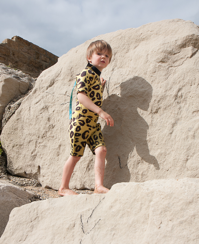 Henry wearing a leopard print wetsuit made by Saltskin