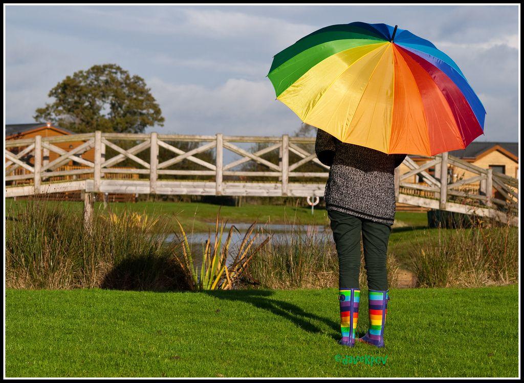 13. Girl with rainbow wellies and a rainbow multi coloured umbrella