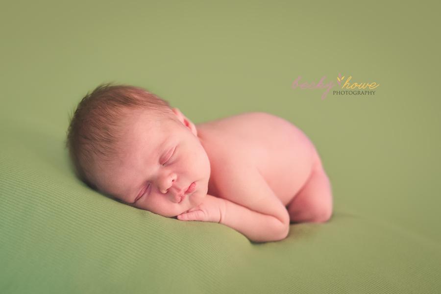 newborn boy sleeping pose photography green