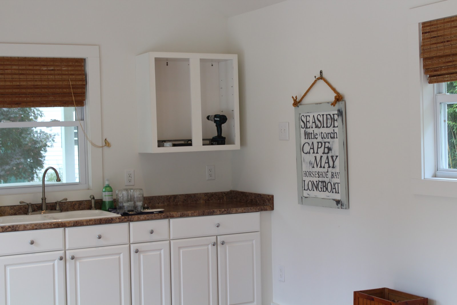 Pine tree home weekend projects mirror cabinet and caulk for Caulking around kitchen cabinets