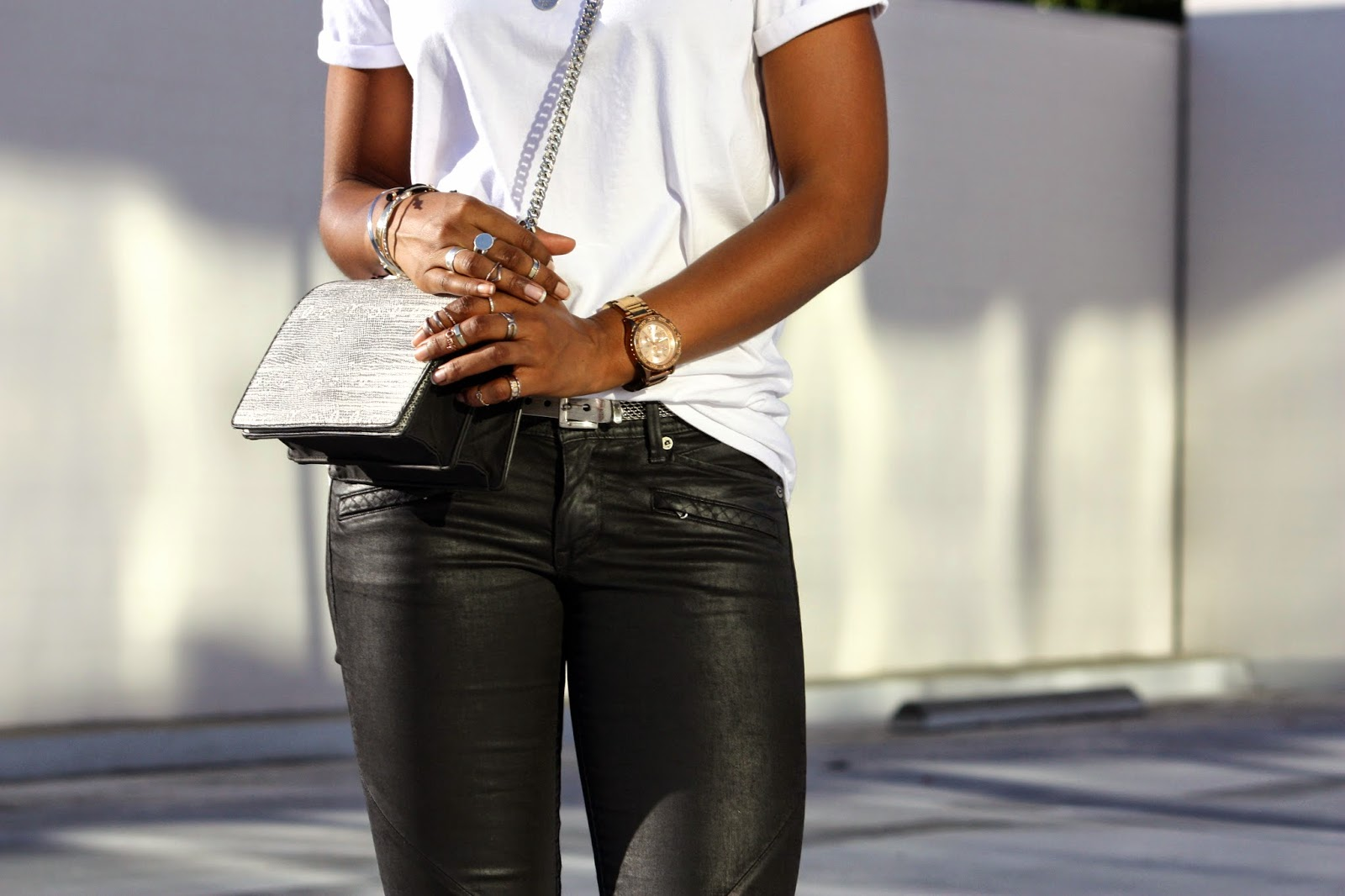 Wearing H&M crossbody bag Nixon rose-gold watch with assorted rings