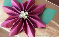 http://blossomsandposies.com/blog/origami-poinsettia-gift-topper/