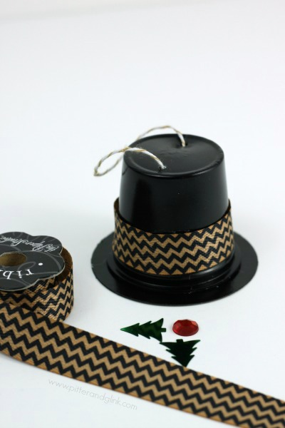 Embellish the K-Cup hats with ribbon, rhinestones, and confetti.  pitterandglink.com