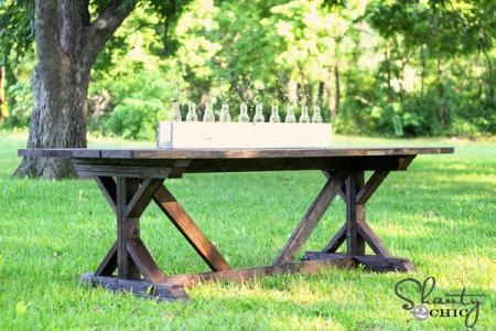 http://ana-white.com/2012/06/plans/fancy-x-farmhouse-table