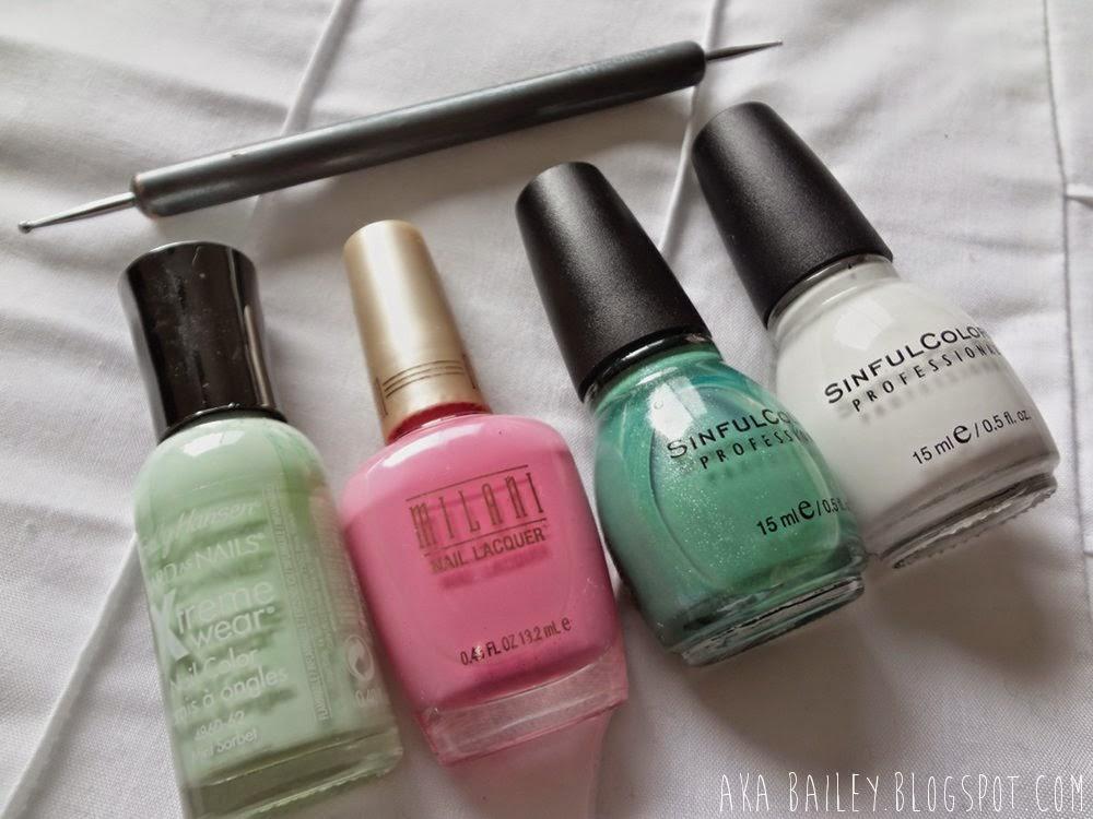 Mint pastel polish, pink nail polish, white polish, dotting tool