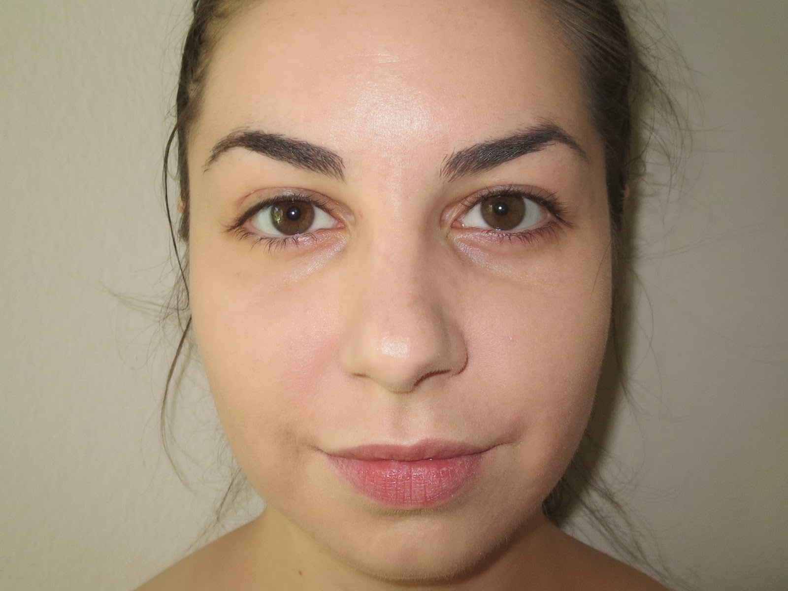a picture of results after one pump of Physician's Formula Touch of Glow Foundation in Light on skin