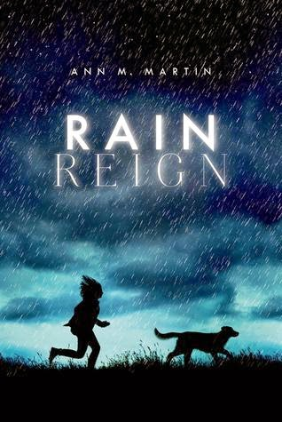 Book cover, Rain Reign by Ann M. Martin. Image shows the silhouettes of a girl and dog running through a field during an evening rain.